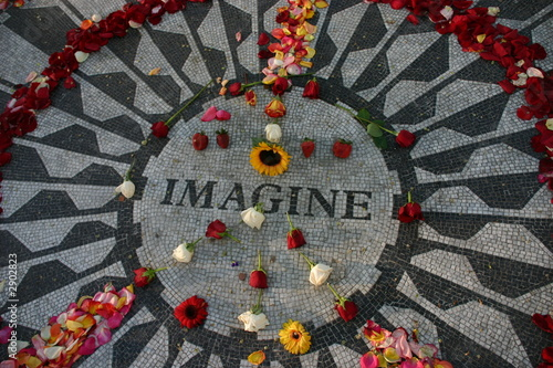 "Photo  ""imagine"" monument with flowers in peace sign"