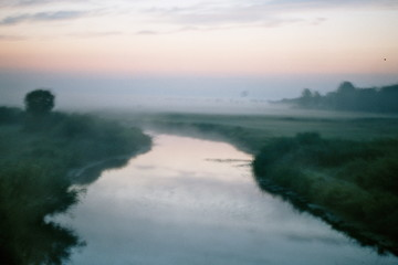 Fototapetafog and river