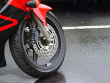 Motorcycle Tire In The Rain