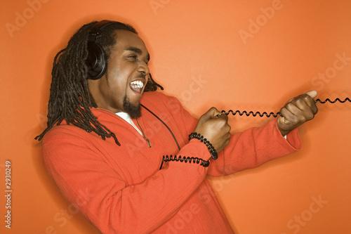Fotografie, Obraz  african-american man wearing headphones.