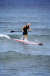 canvas print picture - surfing with an oar