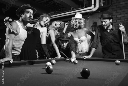 Obraz retro group trying to distract man as he takes pool shot. - fototapety do salonu