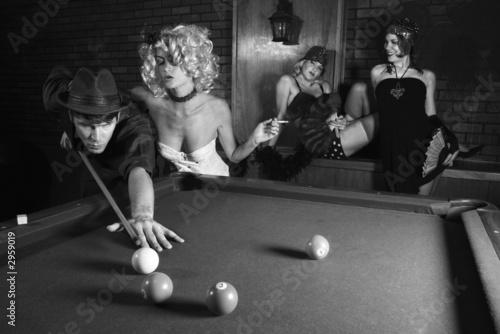 Fotografie, Tablou  retro male shooting pool with three retro females watching.