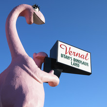 Pink Dinosaur Holding Sign For...
