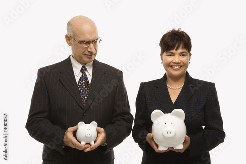 Fototapeta businesspeople holding piggybanks.