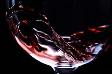 Fototapeta Do jadalni closeup of red wine pouring