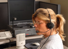 Police Dispatcher Sitting At A...