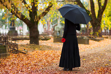Woman In Mourning At Cemetery ...