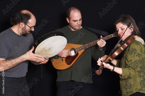 band playing celtic music - Buy this stock photo and explore similar