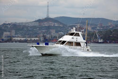 Poster Nautique motorise motorboat speeding along golden horn bay