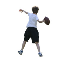 Boy Throwing Football (with Clipping Path)