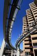 futuristic monorail going around skyscrapers
