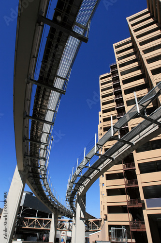 Etiqueta engomada - futuristic monorail going around skyscrapers
