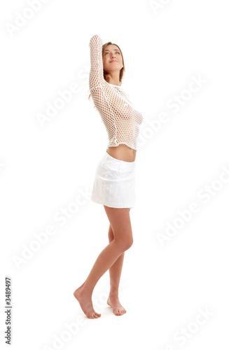 Valokuva  lovely girl in fishnet shirt and white skirt