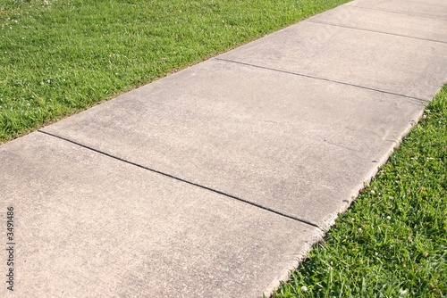 Fotografiet Abstract background of concrete sidewalk and grass