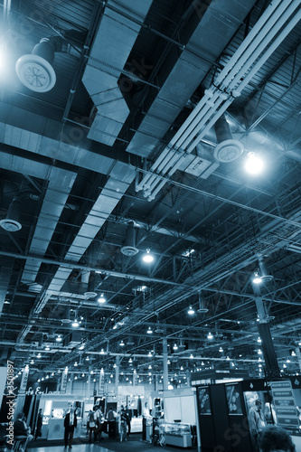 Staande foto Industrial geb. huge industrial space hosting a trade show