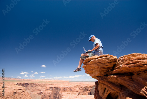 Photo Stands Night blue USA. Arizona. Page. Horseshoe Bend. Man with notebook