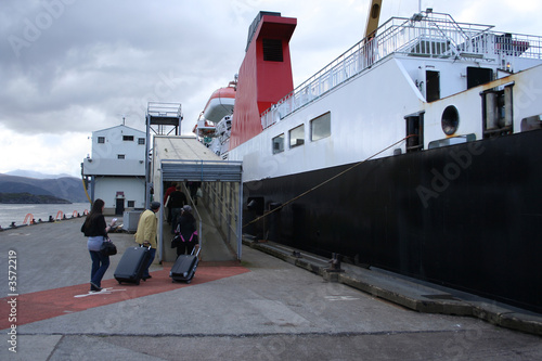 Fototapeta passengers boarding ferry