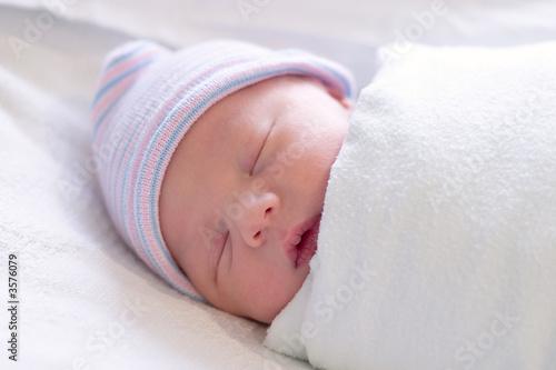 Newborn baby boy sleeping in hospital