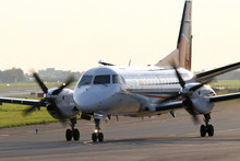 Turboprop Airplane On Taxiway