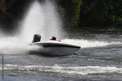 A speed boat on the river