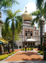 A Girl Standing In Front Of Sultan Mosque Singapore