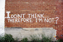 Graffiti Message Painted Onto Old Red Brick Wall