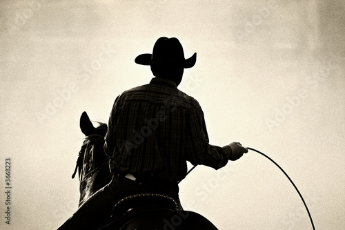 Papel de parede cowboy at the rodeo - shot backlit against dust, added grain