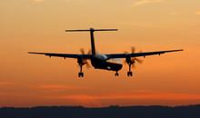 Turboprop Landing At Sunset