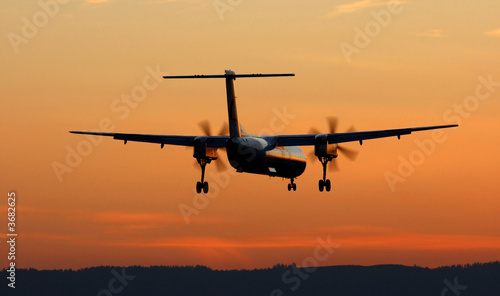 Photo  Turboprop Landing At Sunset