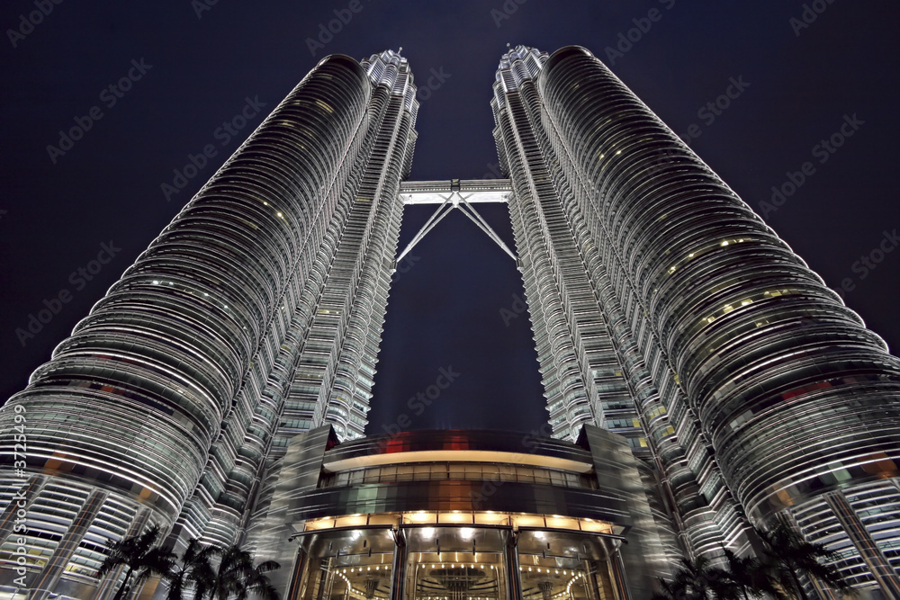 Fototapeta Wide-angle view of the Petronas twin-towers at sunset