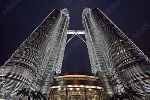 Wide-angle view of the Petronas twin-towers at sunset