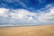 Sunny beach blue sky and golden sand