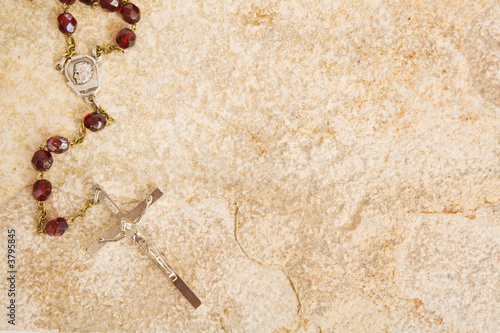 Valokuvatapetti Rosary beads on a sandstone background