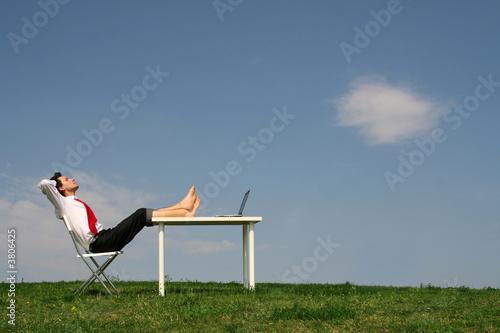 Papiers peints Detente Businessman using laptop outdoors