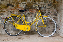 Old Yellow Bike On The Wall