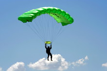 Parachuter And Cloud