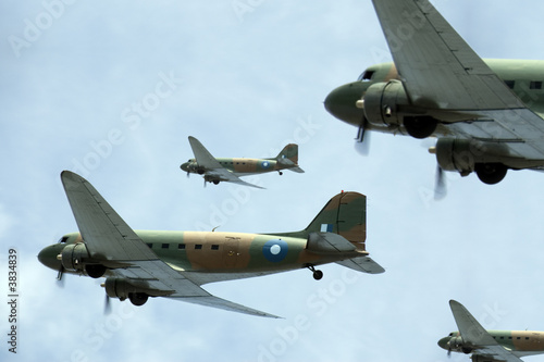 Photo  A flight of transport planes banking to starboard.