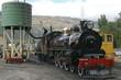 Vintage steam train fetching water