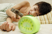 Daily Morning Battle Between Boy And Alarm Clock
