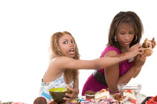 Two Black Girls Fighting Over A Bunch Of Muffins