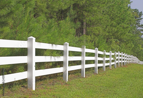 Fotografie, Obraz  A decorative white split rail fence.