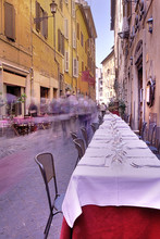 Street Scene From Rome, Italy Depicting A Restaurant