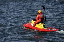Rescuer Riding Brightly Colored Jetski