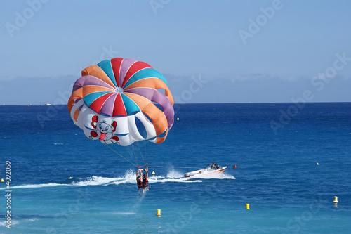 Carta da parati a motorboat with parachute prepared for parasailing