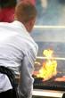 cook in white suit preparing barbecue