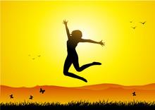 Happy Girl Jumping At Sunset
