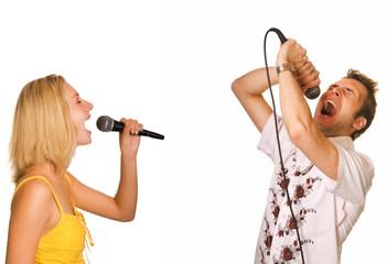 Fototapeta Couple singing karaoke isolated on white background