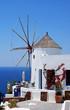 Leinwandbild Motiv Windmill on Santorini island