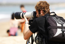 Photographe Entrain De Zoomer